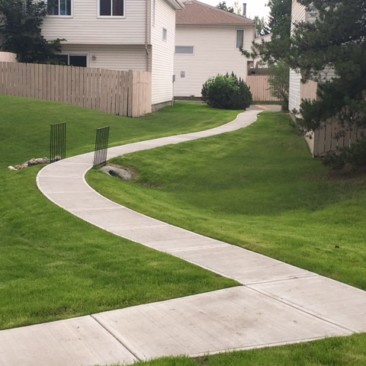 Custom curved sidewalk with culvert and safty railing
